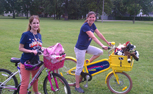 Brown County Library Children's Librarian Katie Guzek and Library Associate Angela Zuidmulder take the BCL Book Bike to a local park.