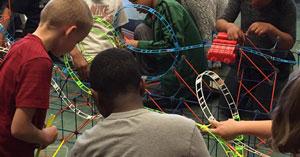 Children building a roller coaster at Building Up: Architecture Program