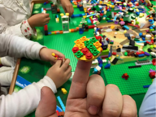 Children building with LEGOs