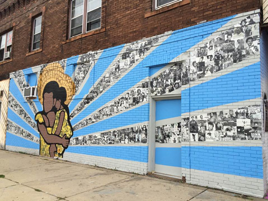 """Who We Are,"" a mural designed by youth and adult artists in Juxtaposition Arts' Public Art Studio. Located at 1100 West Broadway Ave. in Minneapolis, Minnesota."