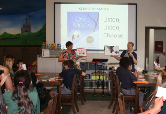 Teacher Kathi Stalzer and school librarian Debra LaPlante at Saints Simon and Jude Cathedral School in Phoenix, Arizona, co-teaching a strategy lesson with fourth-grade students.