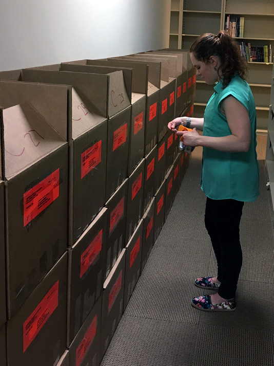 ALSC awards intern Corinne Demyanovich prepares the 2017 Bookapalooza award for shipment. Photo courtesy of ALSC.