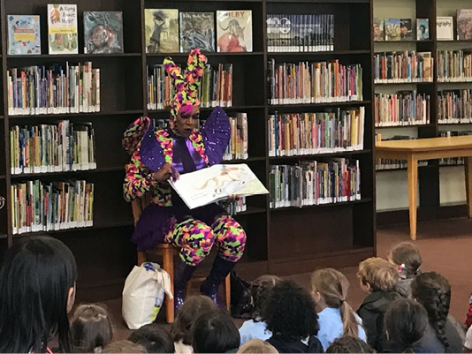 Drag Queen Harmonica Sunbeam reads to pre-K students at Hudson Park Library in New York.