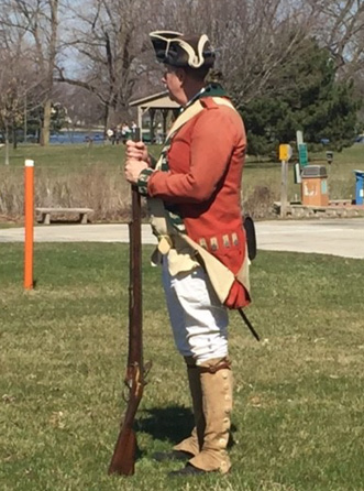 One of the re-enactors, complete with gun and tri-corner hat