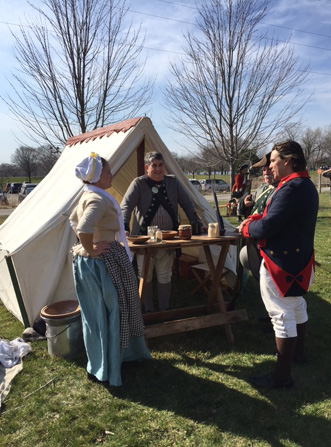 Revolutionary War re-enactors set up camp outside the Kress Family Branch Library in De Pere, Wisconsin