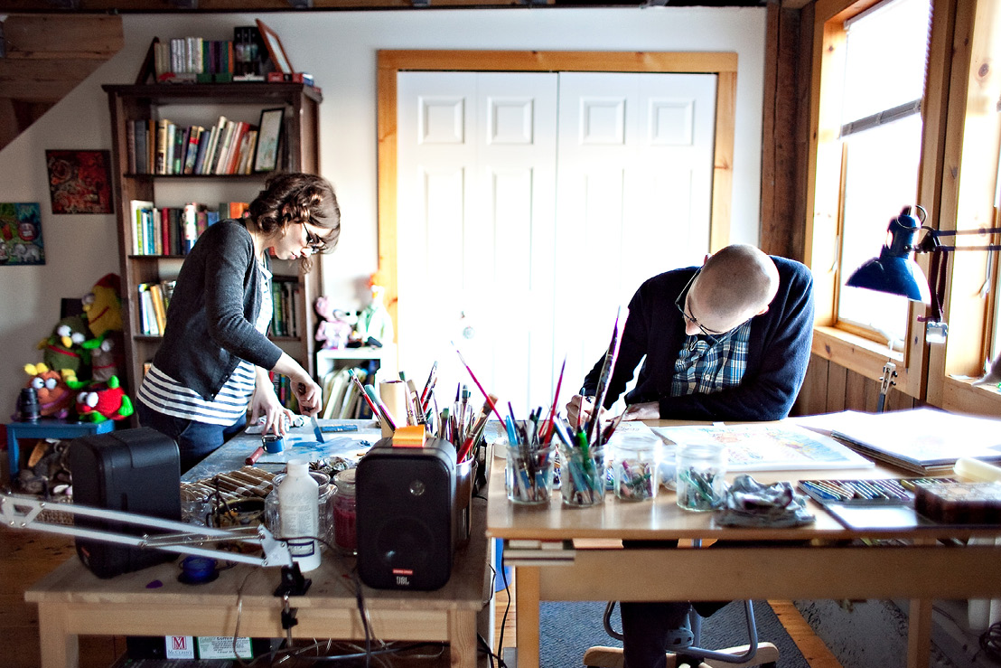 The Steads working in their home studio.