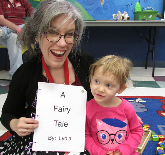 Librarian Laura Raphael and her little literary friend Lydia.
