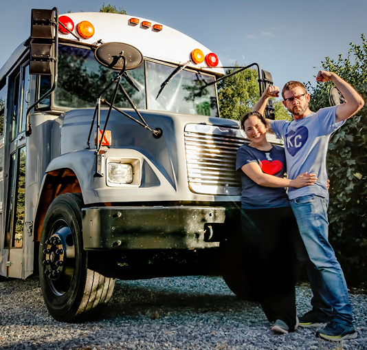 Robbi Behr and Matthew Swanson in front of their school bus.